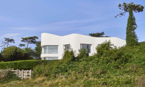 This green-roofed castle home in England is cooled by the ocean breeze